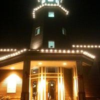 Photo taken at Lighthouse Restaurant & Lounge by Amanda K. on 12/8/2011