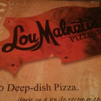 Photo taken at Lou Malnati's Pizzeria by Jessica M. on 3/20/2012