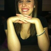 Photo taken at Linger Cafe & Lounge by Dan P. on 3/4/2012