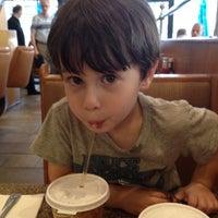 Photo taken at Gracie Mews Diner by Loren R. on 8/3/2012