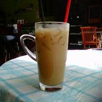Photo taken at Pan Cafe by Lisa S. on 11/30/2011