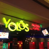 Photo taken at Yolös Mexican Grill by Charles A. on 7/20/2012