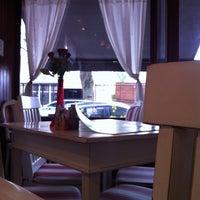 Photo taken at Café des Fleurs by Lak L. on 3/18/2012