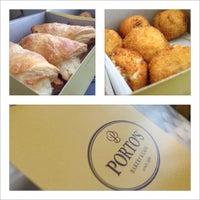 Photo taken at Porto's Bakery & Cafe by Richard G. on 5/12/2012