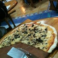 Photo taken at Pepe's Pizza by Ingrid on 7/20/2012