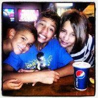 Photo taken at Pott's Sports Cafe by Iris S. on 9/9/2012