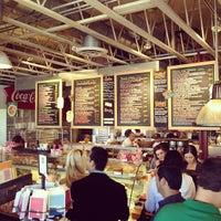 Photo taken at La Grande Orange Grocery & Pizzeria by Bryan S. on 1/29/2012