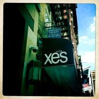 Photo taken at XES Lounge by Pete L. on 6/21/2012