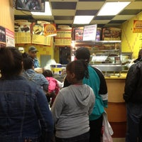 Photo taken at Golden Krust Caribbean Bakery and Grill by Devon D. on 4/14/2012