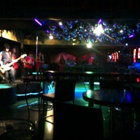 Photo taken at Pitstop Bar & Lounge by Valeo G. on 9/29/2011
