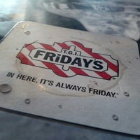 Photo taken at TGI Fridays by Cynthia C. on 9/9/2012