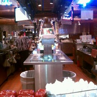 Photo taken at Smokey Bones Bar & Fire Grill by Anthony D. on 1/21/2012