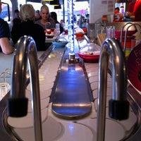 Photo taken at YO! Sushi by Luke R. on 4/15/2012