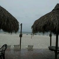 Photo taken at Undertow Beach Bar by Christine G. on 8/26/2012