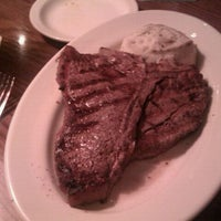 Photo taken at Outback Steakhouse by John G. on 9/23/2011