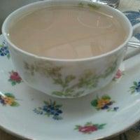Photo taken at A Corner of England Tea Room by Lauren R. on 12/27/2011