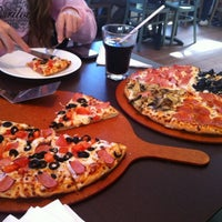 Photo taken at Pizza Hut by Claudia L. on 4/5/2012