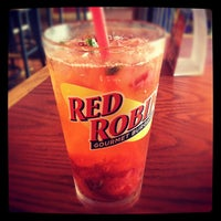 Photo taken at Red Robin Gourmet Burgers by Vanessa H. on 7/22/2012