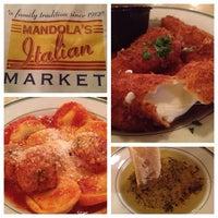 Photo taken at Mandola's Italian Market by Rory E. on 4/29/2012
