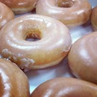 Photo taken at Krispy Kreme Doughnuts by Ryan S. on 6/18/2012