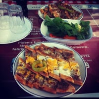 Photo taken at Dost Pide & Pizza by Özgün C. on 8/24/2012