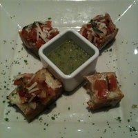 Photo taken at BJ's Restaurant and Brewhouse by Debi H. on 4/9/2011