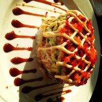 Photo taken at Manu's Tapas Bar & Sushi Lounge by Matt on 6/7/2012