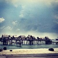 Photo taken at Palawan Beach by Zelin Z. on 9/7/2012