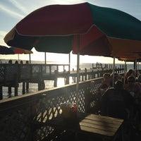 Photo taken at Dewey Destin's Seafood & Restaurant by Kent O. on 3/20/2012