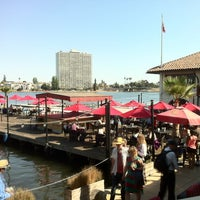 Photo taken at The Lake Chalet Seafood Bar & Grill by TJ D. on 8/12/2012