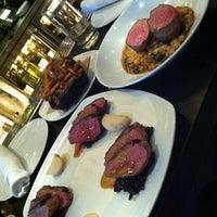 Photo taken at Sustain restaurant + bar by Marcela L. on 3/28/2012