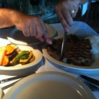 Photo taken at New Campo Argentino SteakHouse by Danielle P. on 5/23/2012