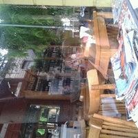 Photo taken at Di Vino Vinoteca Cafe Bar by Belu M. on 2/21/2012