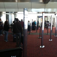 Photo taken at Gate C30 by Katie B. on 4/13/2012