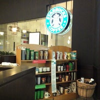 Photo taken at Starbucks by f irene S. on 8/30/2012