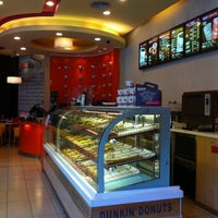 Photo taken at Dunkin Donuts @ Golden Central Tower by Matthew on 7/31/2012