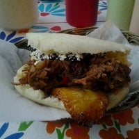 Photo taken at Arepera Guacuco Restaurant by Mani K. on 8/28/2012