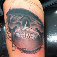 Photo taken at Funhouse Tattoo SD by Roger S. on 8/29/2012