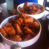 Photo taken at Buffalo Wings & Rings by Kelly M. on 6/27/2012