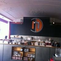 Photo taken at Nosh Kitchen Bar by Hollie C. on 5/17/2012