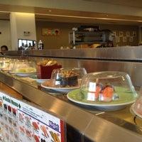 Photo taken at Marinepolis Sushi Land by Emily H. on 4/1/2012