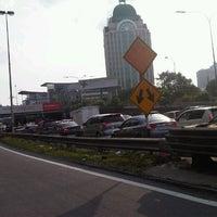 Photo taken at Lebuhraya Persekutuan (Federal Highway) by Kim H. on 7/23/2012