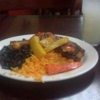 Photo taken at Sophie's Cuban Cuisine by Regina W. on 5/14/2012