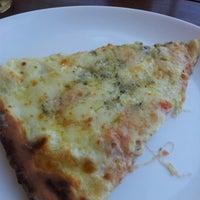 Photo taken at Pomodori Pizza by Fernanda R. on 7/5/2012
