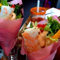Photo taken at Blowfish Restaurant & Sake Bar by Christopher M. on 6/24/2012