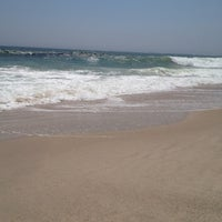 Photo taken at Ponquogue Beach by Christina R. on 7/16/2012
