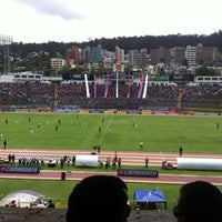 Photo taken at Estadio Olimpico Atahualpa by Rodrigo E. on 2/26/2012
