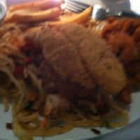 Photo taken at Landry's Seafood House by Tee W. on 3/16/2012