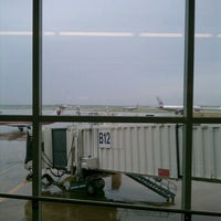 Photo taken at Gate B12 by Mac N. on 4/20/2012