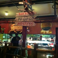 Photo taken at Dinosaur Bar-B-Que by Michelle on 6/18/2012